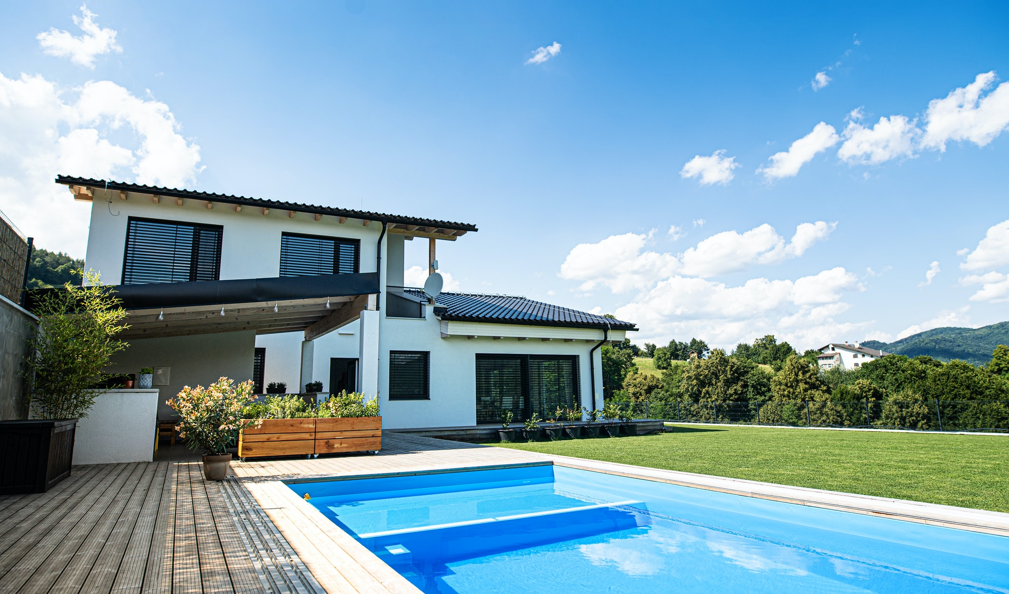 House with swimming pool outdoors in backyard garden